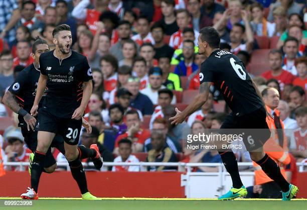 Liverpool's Adam Lallana celebrates scoring his side's second goal of the game with teammate Dejan Lovren