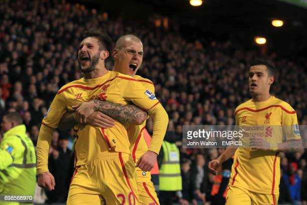 Liverpool's Adam Lallana celebrates with teammates Martin Skrtel and Philipe Coutinho after scoring his sides second goal of the game