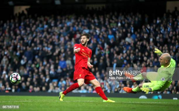 Liverpool's Adam Lallana misses a chance from six yards as Manchester City goalkeeper Willy Caballero looks on