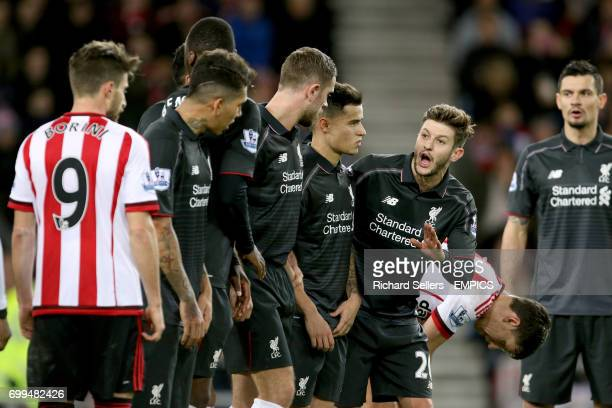 Liverpool's Adam Lallana organises the defensive wall for a free kick