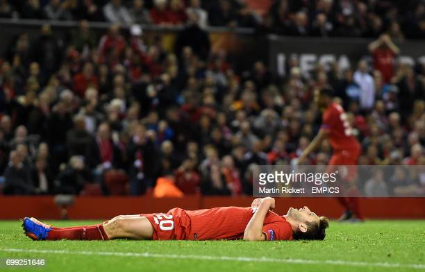 Liverpool's Adam Lallana reacts after a missed chance against FC Sion