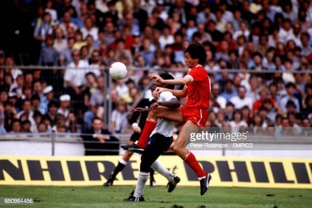 Liverpool's Alan Hansen tries to clear from Tottenham Hotspur's Garth Crooks