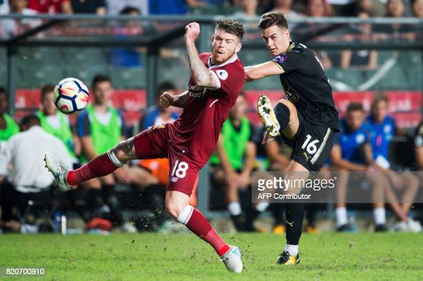 Liverpool's Alberto Moreno and Leicester City's Tom Lawrence compete for the ball during the final of the Premier League Asia Trophy football...