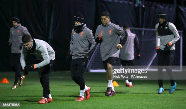 Liverpool's Alberto Moreno Philippe Coutinho Roberto Firmino and Dominic Solanke during a training session at Melwood Training Ground Liverpool