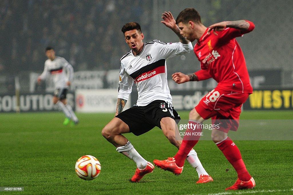 Liverpool's Alberto Moreno vies for the ball with Besiktas' Jose Sosa during the secondleg Round of 32 UEFA Europa League football match Besiktas vs...