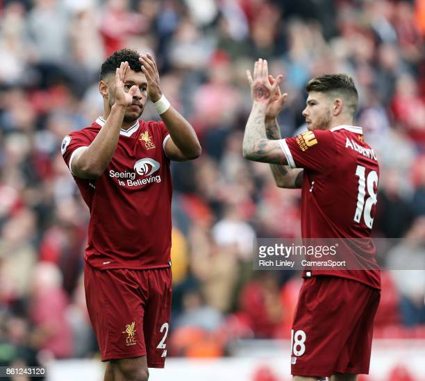 Liverpool's Alex OxladeChamberlain and Alberto Moreno applaud the fans at the final whistle during the Premier League match between Liverpool and...