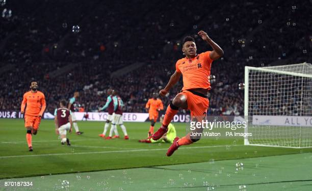 Liverpool's Alex OxladeChamberlain celebrates scoring his side's third goal of the game during the Premier League match at the London Stadium