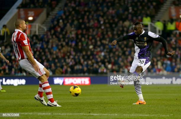 Liverpool's Aly Cissokho strikes the ball which was deflected for an own goal by Stoke City's Ryan Shawcross