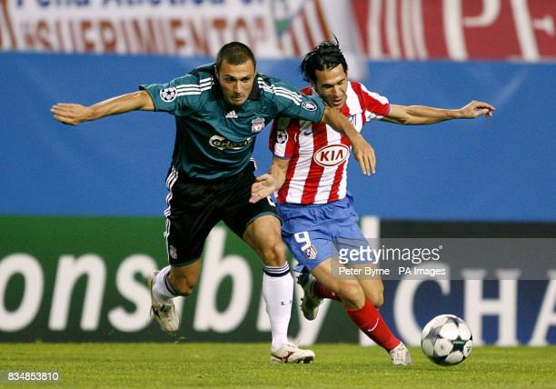 Liverpool's Andrea Dossena and Athletico Madrid's Luis Garcia battle for the ball