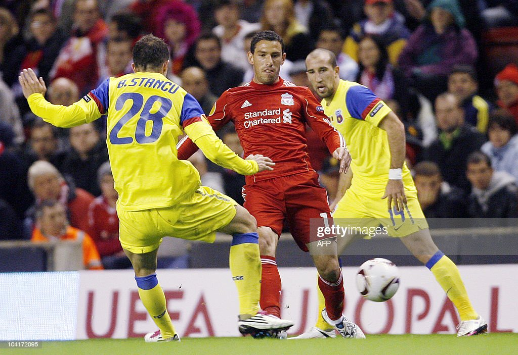 Liverpool's Argentinian midfielder Maxi Rodri­guez (C) is challanged by Steaua Bucarest (L) Bogdan Stancu during the UEFA Europa League football match Liverpool vs Steaua Bucarest, on September 16, 2010 at the Anfield stadium in Liverpool.