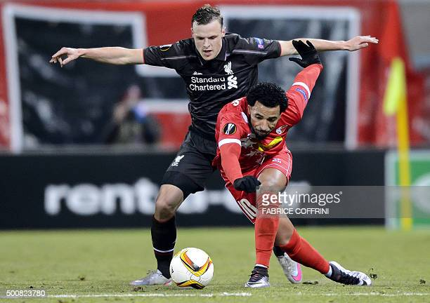 Liverpool's Australian defender Brad Smith and Sion's Portugese midfielder Carlitos vie for the ball during the UEFA Europa League group B football...