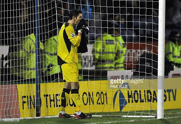 Liverpool's Australian goalkeeper Brad Jones reacts after conceeding the third goal during the English FA Cup fourth round football match between...