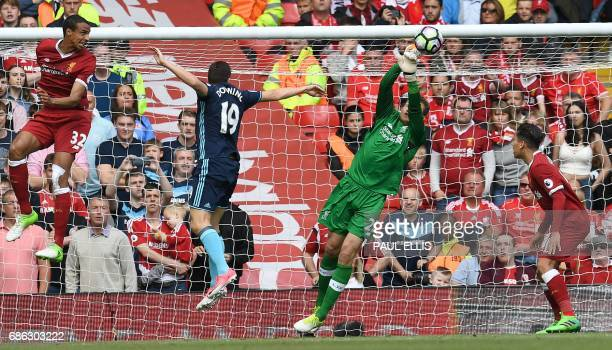 Liverpool's Belgian goalkeeper Simon Mignolet clears the ball fromthe path of Middlesbrough's English midfielder Stewart Downingduring the English...