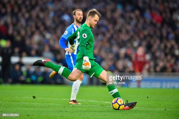 Liverpool's Belgian goalkeeper Simon Mignolet kicks a clearence during the English Premier League football match between Brighton and Hove Albion and...
