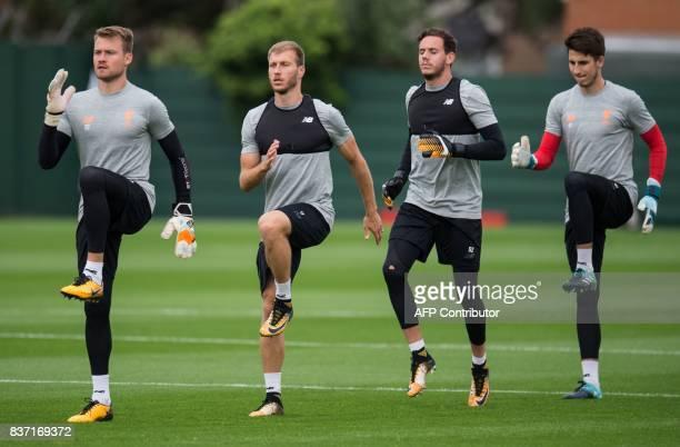 Liverpool's Belgian goalkeeper Simon Mignolet Liverpool's Estonian defender Ragnar Klavan and Liverpool's Welsh goalkeeper Danny Ward attend a team...