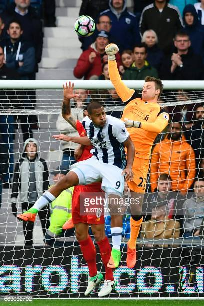 Liverpool's Belgian goalkeeper Simon Mignolet punches the ball clear during the English Premier League football match between West Bromwich Albion...