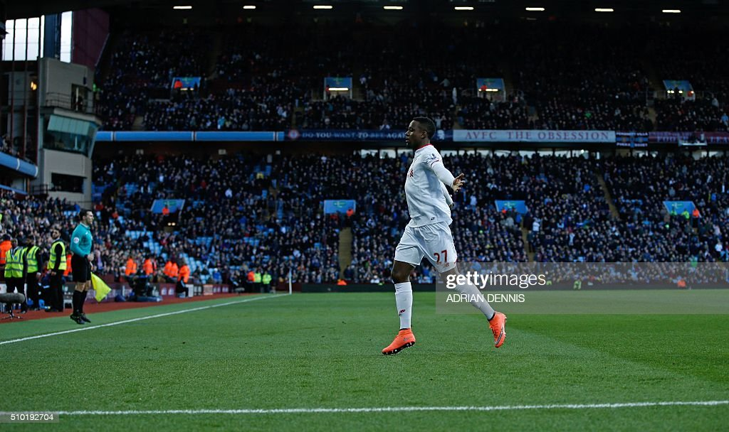 Liverpool's Belgian striker Divock Origi celebrates scoring his team's fourth goal during the English Premier League football match between Aston Villa and Liverpool at Villa Park in Birmingham, central England on February 14, 2016. Liverpool won the match 6-0. / AFP / ADRIAN DENNIS / RESTRICTED TO EDITORIAL USE. No use with unauthorized audio, video, data, fixture lists, club/league logos or 'live' services. Online in-match use limited to 75 images, no video emulation. No use in betting, games or single club/league/player publications. /