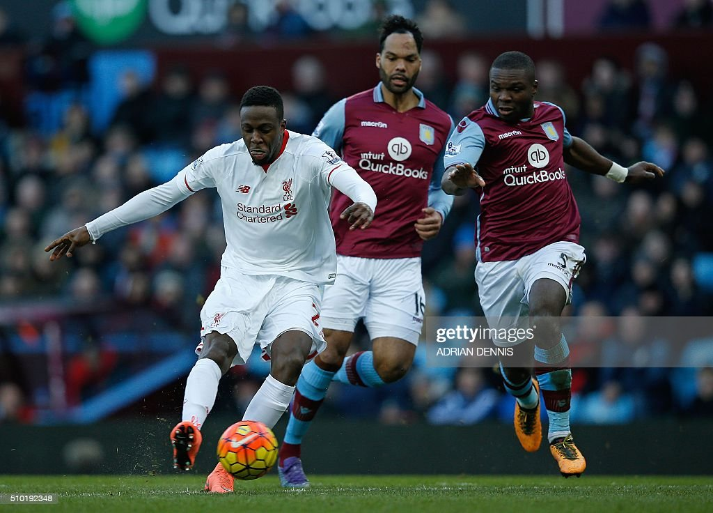 Liverpool's Belgian striker Divock Origi (L) scores his team's fourth goal during the English Premier League football match between Aston Villa and Liverpool at Villa Park in Birmingham, central England on February 14, 2016. / AFP / ADRIAN DENNIS / RESTRICTED TO EDITORIAL USE. No use with unauthorized audio, video, data, fixture lists, club/league logos or 'live' services. Online in-match use limited to 75 images, no video emulation. No use in betting, games or single club/league/player publications. /