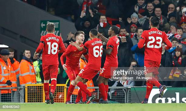 Liverpool's Ben Woodburn celebrates scoring his side's second goal of the game with teammates during the EFL Cup Quarter Final match at Anfield...
