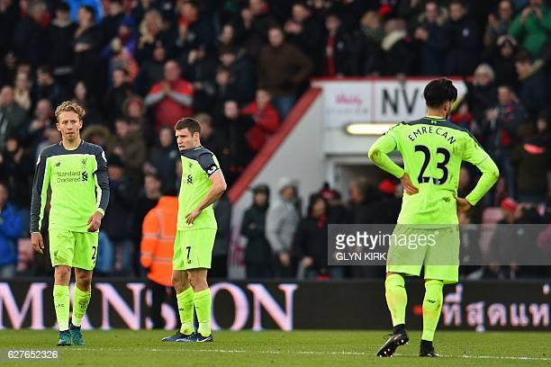 Liverpool's Brazilian midfielder Lucas Leiva Liverpool's English midfielder James Milner and Liverpool's German midfielder Emre Can react to their...