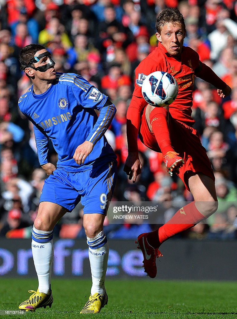 "Liverpool's Brazilian midfielder Lucas Leiva (R) vies with Chelsea's Spanish striker Fernando Torres (L) during the English Premier League football match between Liverpool and Chelsea at the Anfield stadium in Liverpool, northwest England, on April 21, 2013. The game finished 2-2. USE. No use with unauthorized audio, video, data, fixture lists, club/league logos or ""live"" services. Online in-match use limited to 45 images, no video emulation. No use in betting, games or single club/league/player publications."