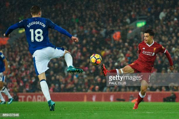 Liverpool's Brazilian midfielder Philippe Coutinho and Everton's Icelandic midfielder Gylfi Sigurdsson go for the ball during the English Premier...