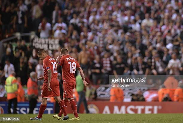 Liverpool's Brazilian midfielder Philippe Coutinho and Liverpool's Spanish defender Alberto Moreno react as they leave the pitch after the UEFA...