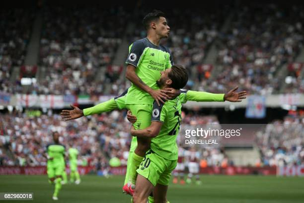 Liverpool's Brazilian midfielder Philippe Coutinho and Liverpool's English midfielder Adam Lallana celebrate their third goal during the English...