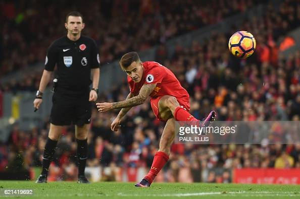 Liverpool's Brazilian midfielder Philippe Coutinho attempts a shot at goal during the English Premier League football match between Liverpool and...