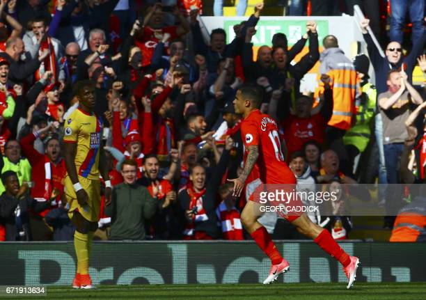 Liverpool's Brazilian midfielder Philippe Coutinho celebrates after scoring during the English Premier League football match between Liverpool and...
