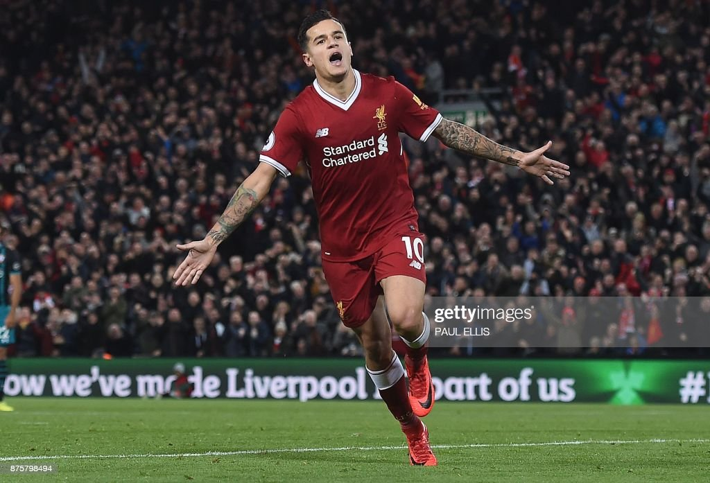 Liverpool's Brazilian midfielder Philippe Coutinho celebrates scoring his team's third goal during the English Premier League football match between Liverpool and Southampton at Anfield in Liverpool, north west England on November 18, 2017. / AFP PHOTO / PAUL ELLIS / RESTRICTED TO EDITORIAL USE. No use with unauthorized audio, video, data, fixture lists, club/league logos or 'live' services. Online in-match use limited to 75 images, no video emulation. No use in betting, games or single club/league/player publications. /