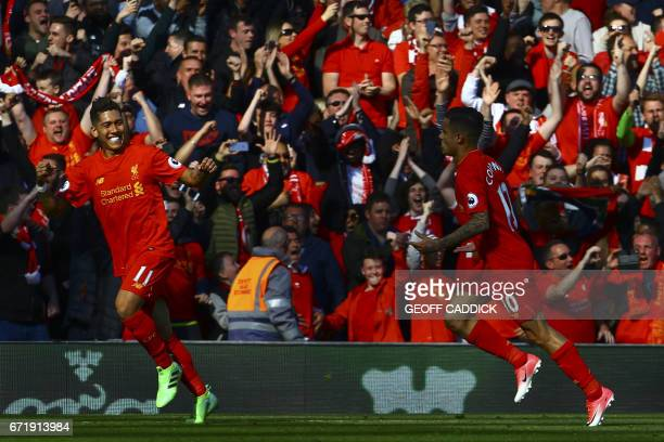 Liverpool's Brazilian midfielder Philippe Coutinho celebrates with Liverpool's Brazilian midfielder Roberto Firmino after scoring during the English...