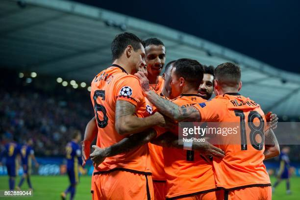 Liverpool's Brazilian midfielder Philippe Coutinho celebrates with teammates after scoring a goal during the UEFA Champions League match between NK...