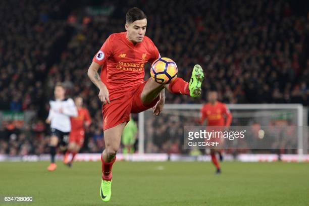 Liverpool's Brazilian midfielder Philippe Coutinho controls the ball during the English Premier League football match between Liverpool and Tottenham...