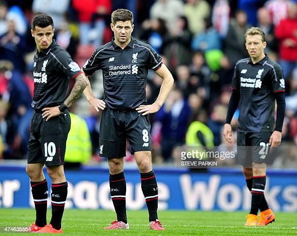 Liverpool's Brazilian midfielder Philippe Coutinho Liverpool's English midfielder Steven Gerrard and Liverpool's Brazilian midfielder Lucas Leiva...