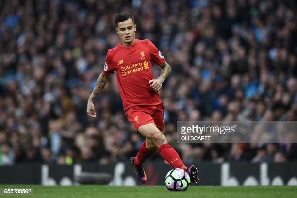 Liverpool's Brazilian midfielder Philippe Coutinho runs with the ball during the English Premier League football match between Manchester City and...