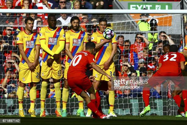 Liverpool's Brazilian midfielder Philippe Coutinho scores during the English Premier League football match between Liverpool and Crystal Palace at...