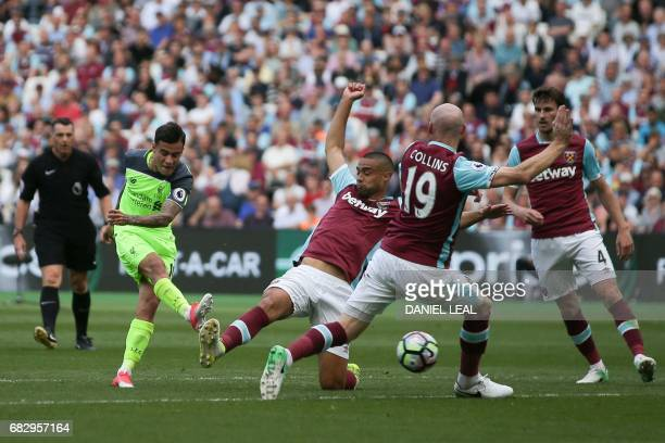 Liverpool's Brazilian midfielder Philippe Coutinho shoots past West Ham United's Welsh defender James Collins to score the second goal during the...