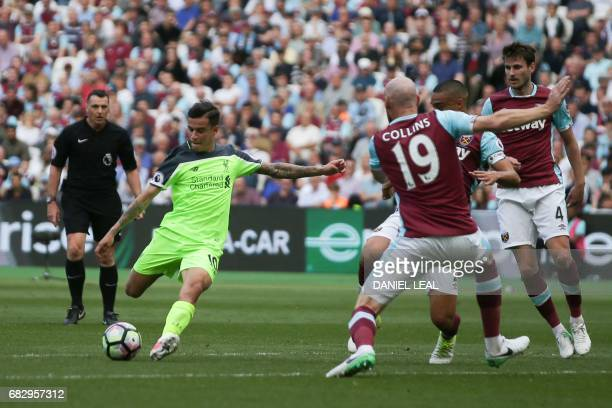 Liverpool's Brazilian midfielder Philippe Coutinho shoots past West Ham United's Welsh defender James Collins to score the team's second goal during...