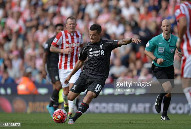 Liverpool's Brazilian midfielder Philippe Coutinho shoots to score the opening goal of the English Premier League football match between Stoke City...