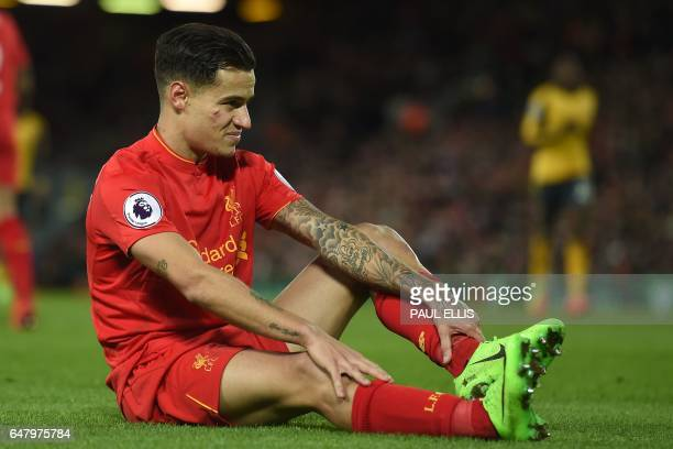 Liverpool's Brazilian midfielder Philippe Coutinho takes a tumble during the English Premier League football match between Liverpool and Arsenal at...