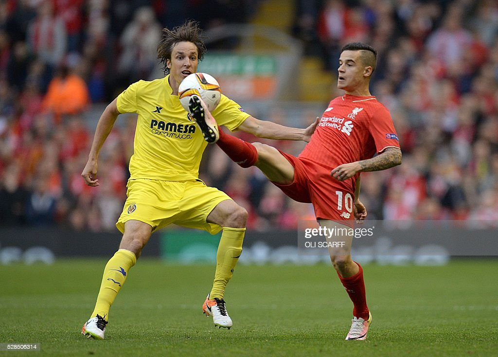 Liverpool's Brazilian midfielder Philippe Coutinho (R) vies for the ball against Villarreal's midfielder Tomas Pina during the UEFA Europa League semi-final second leg football match between Liverpool and Villarreal CF at Anfield in Liverpool, northwest England on May 5, 2016. / AFP / OLI