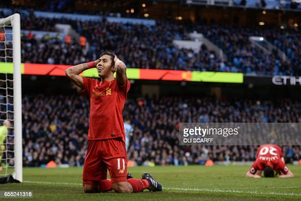 Liverpool's Brazilian midfielder Roberto Firmino and Liverpool's English midfielder Adam Lallana react after missing a good chance during the English...