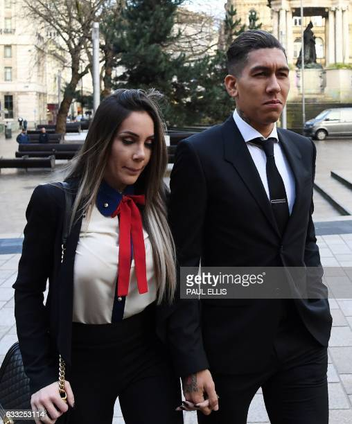 Liverpool's Brazilian midfielder Roberto Firmino and wife Larissa Pereira arrive at Liverpool Magistrates Court in Liverpool northwest England on...