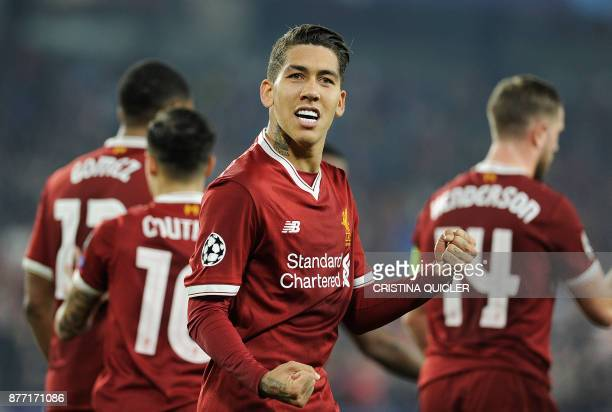 TOPSHOT Liverpool's Brazilian midfielder Roberto Firmino celebrates after scoring a goal on November 21 2017 at the Ramon Sanchez Pizjuan stadium in...
