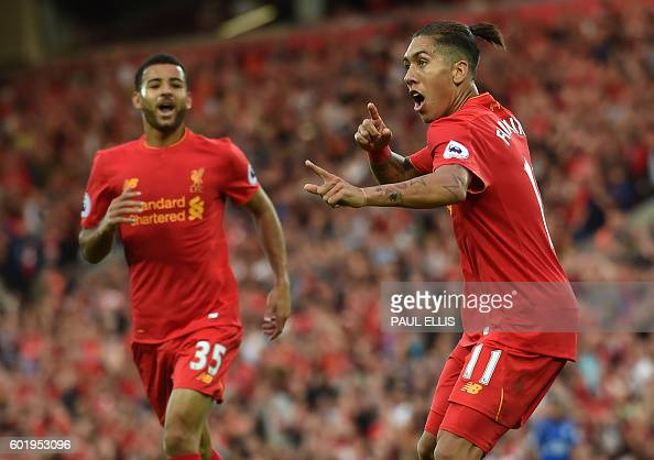 Liverpool's Brazilian midfielder Roberto Firmino celebrates after scoring their fourth goal during the English Premier League football match between...