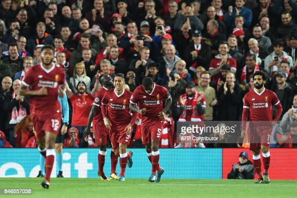 Liverpool's Brazilian midfielder Roberto Firmino celebrates after scoring during the UEFA Champions League Group E football match between Liverpool...