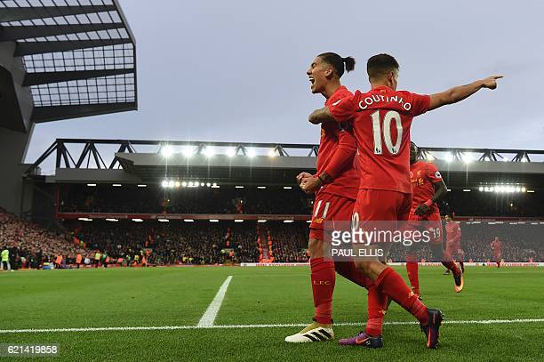 Liverpool's Brazilian midfielder Roberto Firmino celebrates scoring his team's fourth goal Liverpool's Brazilian midfielder Philippe Coutinho with...