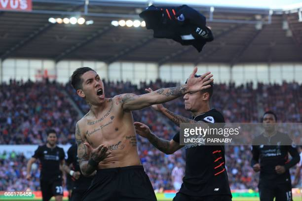 Liverpool's Brazilian midfielder Roberto Firmino celebrates scoring his team's second goal during the English Premier League football match between...