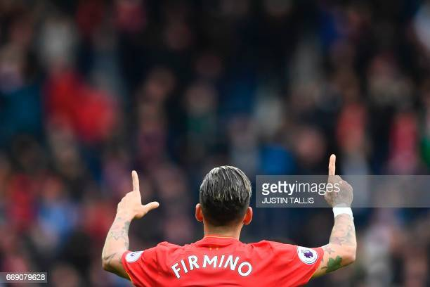 Liverpool's Brazilian midfielder Roberto Firmino celebrates scoring the opening goal during the English Premier League football match between West...